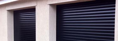 Twin black roller garage door