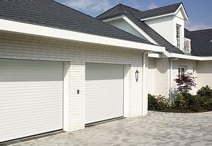 Twin white roller garage doors